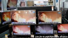 TV screens showi a news program reporting about North Korea's missiles with file footage at an electronic shop in Seoul, South Korea, Thursday, March 25, 2021. North Korea on Thursday test-fired its first ballistic missiles since U.S. President Joe Biden took office, as it expands its military capabilities and increases pressure on Washington while nuclear negotiations remain stalled. The Korean characters read: Joint Chiefs of Staff, South Korea and U.S. intelligence authorities, analyzing the missiles in detail. (AP Photo/Lee Jin-man)