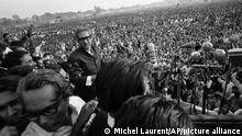 FILE - In this Jan. 11, 1972, file photo, Bengali nationalist leader Sheikh Mujibur Rahman walks towards a battery of microphones to address an estimated one million people at a rally in Dacca's Race Course Ground. Bangladesh is celebrating 50 years of independence this year. (AP Photo/Michel Laurent, File)