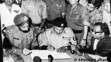 FILE - In this Dec. 16, 1971, file photo, Pakistan's Gen. Niazi, second from left, signs the surrender document as chief of India's Eastern command Gen. Aurora, left, looks on surrounded by other commanders in Dacca, Bangladesh. Bangladesh is celebrating 50 years of independence this year. (AP Photo, File)