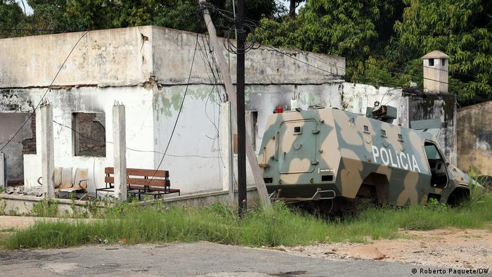 Destroyed military vehicle next to a ransacked post office in Cabo Delgado province