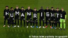 Germany's players pose for a group photo with the wording Human rights on their T-shirts prior to the FIFA World Cup Qatar 2022 qualification football match Germany v Iceland in Duisburg, western Germany on March 25, 2021. (Photo by Tobias SCHWARZ / various sources / AFP) (Photo by TOBIAS SCHWARZ/POOL/AFP via Getty Images)
