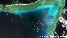 TOPSHOT - This handout satellite imagery taken on March 23, 2021 and received on March 25 from Maxar Technologies shows Chinese vessels anchored at the Whitsun Reef, around 320 kilometres (175 nautical miles) west of Bataraza in Palawan in the South China Sea. - Chinese vessels gathered near a disputed reef in the South China Sea are fishing boats sheltering from poor weather, the foreign ministry said March 22, a day after the Philippines described their presence as an incursion. (Photo by Handout / Satellite image ©2021 Maxar Technologies / AFP) / THE WATERMARK MAY NOT BE REMOVED/CROPPED -----EDITORS NOTE --- RESTRICTED TO EDITORIAL USE - MANDATORY CREDIT AFP PHOTO / Satellite image ©2021 Maxar Technologies - NO MARKETING - NO ADVERTISING CAMPAIGNS - DISTRIBUTED AS A SERVICE TO CLIENTS