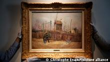 FILE- In this Feb. 25, 2021, file photo, Sotheby's personnel display «Scene de rue à Montmartre» (Street scene in Montmartre), a painting by Dutch master Vincent van Gogh at Sotheby's auction house in Paris. A rare painting by Vincent Van Gogh is being put up for auction by Sotheby's Paris on Thursday, and is expected to sell for many millions. (AP Photo/Christophe Ena, File)