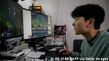 This photo taken on February 8, 2021 shows South Korean gamer Kim Min-kyo streaming computer games at his home near Anyang south of Seoul. - Livestreamers, known as Broadcast Jockeys or BJs in South Korea, are hard-wired to the digital infrastructure of youth culture. - TO GO WITH SKorea-internet-entertainment-social,FOCUS by Daniel DE CARTERET and LIM Seong-uk (Photo by Ed JONES / AFP) / TO GO WITH SKorea-internet-entertainment-social,FOCUS by Daniel DE CARTERET and LIM Seong-uk (Photo by ED JONES/AFP via Getty Images)
