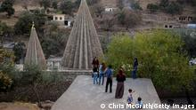 LALISH, IRAQ - NOVEMBER 11: People take photographs at the holiest temple of the Yazidi faith while attending friday rituals on November 11, 2016 in Lalish, Iraq. Lalish is the site of the tomb of Sheikh Adi ibn Musafir, the central figure of the Yazidi faith. In 2014 thousands of Yazidis fled to the villages of Lalish and Shekhan after ISIS took control of Sinjar and other Yazidi populated towns. Many Yazidi resettled in Mosul and Bashiqah but were forced to flee again when ISIS took control of the cities. The liberation of Bashiqah four days ago by the Iraqi army and the continuing Mosul offensive has given many Yazidi 's hope they will soon be able to return home. (Photo by Chris McGrath/Getty Images)