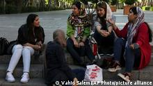 In this Saturday, May 18, 2019 photo, a group of students spend time together after classes in downtown Tehran, Iran. (AP Photo/Vahid Salemi)