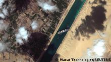 A general view of the Ever Given container ship in Suez Canal, in Suez Canal in this Maxar Technologies satellite image taken on March 27, 2021. Satellite image ©2021 Maxar Technologies/Handout via REUTERS ATTENTION EDITORS - THIS IMAGE HAS BEEN SUPPLIED BY A THIRD PARTY. MANDATORY CREDIT. NO RESALES. NO ARCHIVES. DO NOT OBSCURE LOGO.
