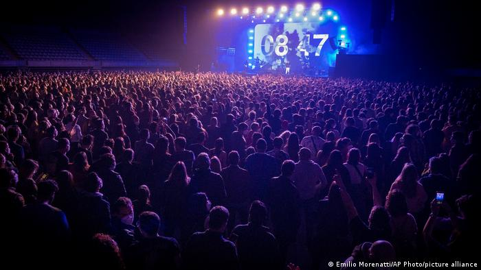 The audience at the music concert by band Love of Lesbian in Spain. (AP Photo/Emilio Morenatti)