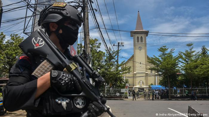 A police officer stands outside Makassar Cathedral