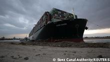 28.03.21 *** Stranded ship Ever Given, one of the world's largest container ships, is seen after it ran aground, in Suez Canal, Egypt March 28, 2021. Suez Canal Authority/Handout via REUTERS ATTENTION EDITORS - THIS IMAGE WAS PROVIDED BY A THIRD PARTY. NO RESALES. NO ARCHIVES