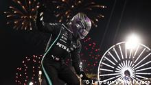 BAHRAIN, BAHRAIN - MARCH 28: Race winner Lewis Hamilton of Great Britain and Mercedes GP celebrates in parc ferme during the F1 Grand Prix of Bahrain at Bahrain International Circuit on March 28, 2021 in Bahrain, Bahrain. (Photo by Lars Baron/Getty Images)