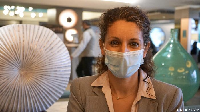 Hotel director Tina Ferrer wearing a surgical face mask