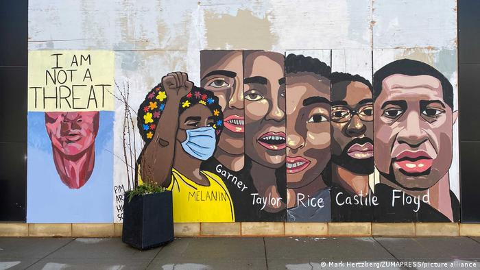 View of a wall on Hennepin Avenue in Minneapolis showing the faces of George Floyd, Eric Garner, Breonna Taylor, Tamir Rice and Philando Castile.