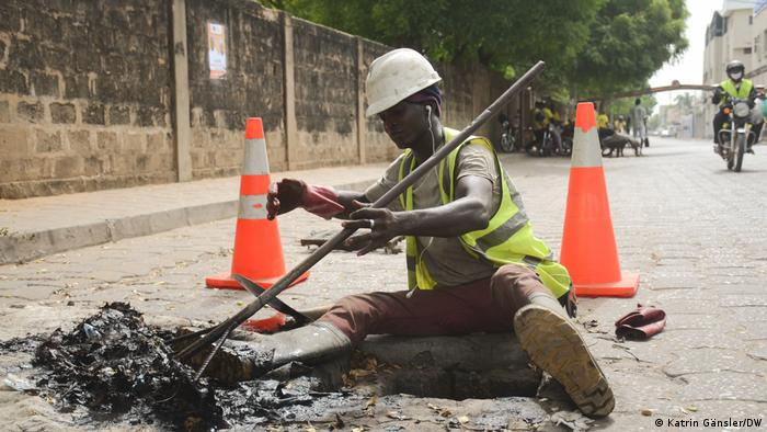 A worker cleaning the city's sewage system