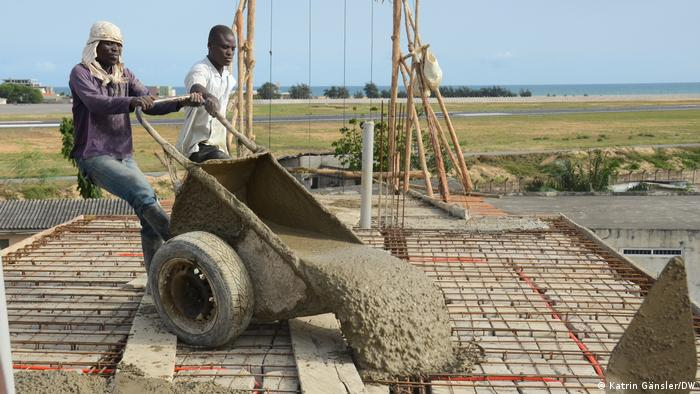 A construction worker laying cement