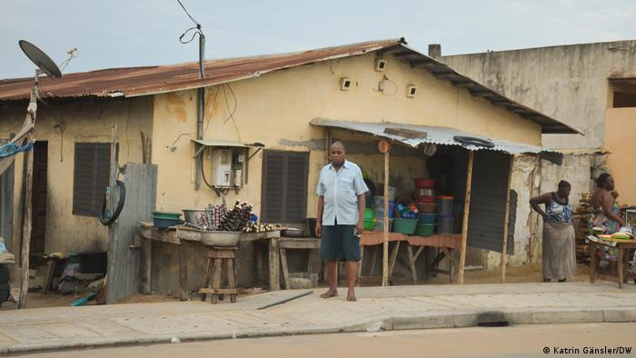 A man standing in front of his house in Cotonou