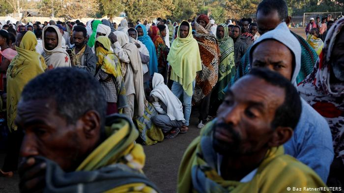 Displaced people queue for food at the Tsehaye primary school