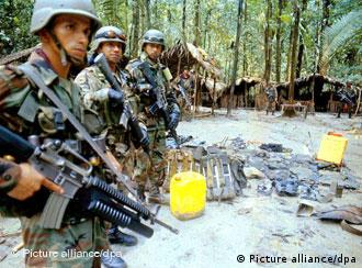Colombian soldiers at a FARC jungle camp