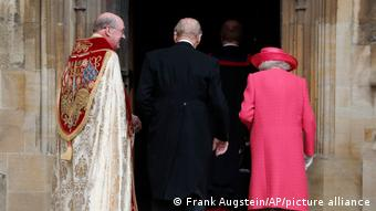 Prince Philip and the Queen seen from behind entering the chapel.