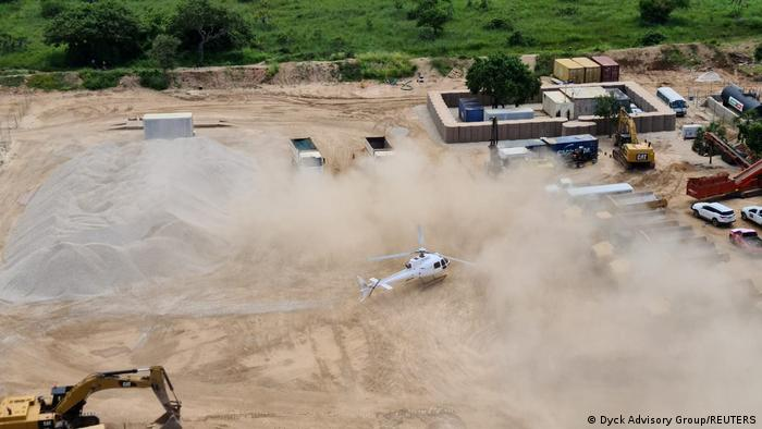A Dyck Advisory Group helicopter lands in Palma, Mozambique