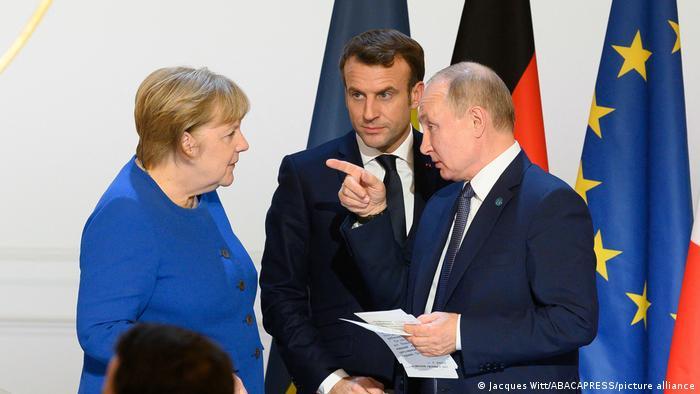 Анґела Меркель, Еммануель Макрон, Володимир Путін (архівне фото)