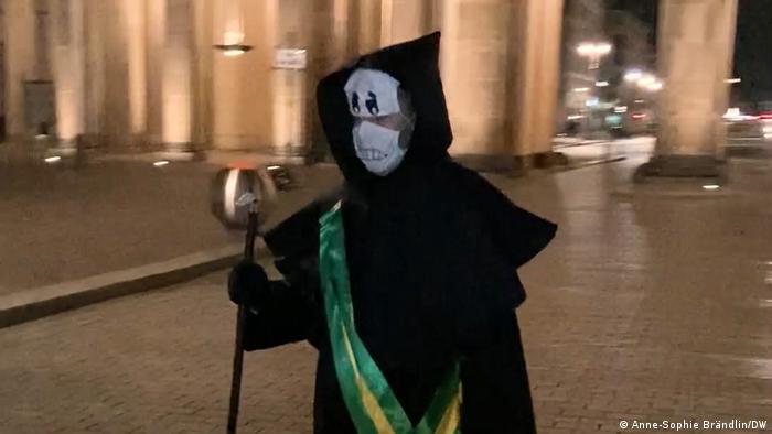 Rafael Pütter dressed as the grim reaper with Brazil sash