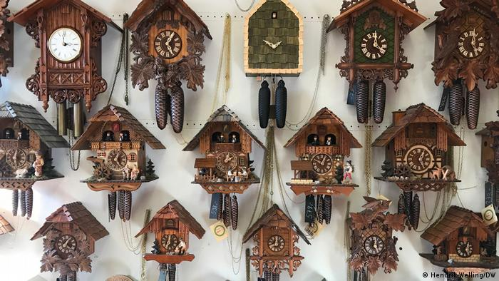 Many cuckoo clocks on the wall of a shop in the Black Forest