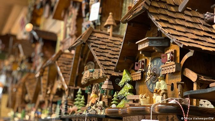 Collection of cuckoo clocks hanging on a wall in the Black Forest, Germany
