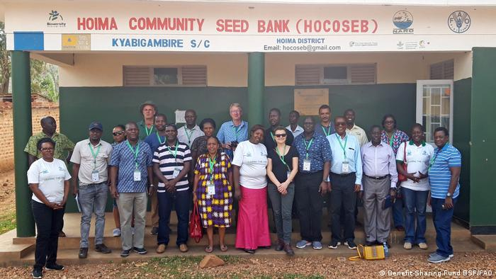 Staff and supporters stand in front of the Hoima Community Seed Bank (CSB) in Uganda