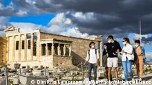 Visitors wearing protective face masks walk past the Parthenon temple atop the Acropolis hill, after archaeological sites open across Greece, following the easing of measures against the coronavirus disease (COVID-19), in Athens, Greece, March 22, 2021. (Photo by Dimitris Lampropoulos/NurPhoto)