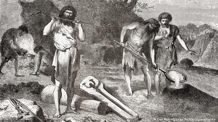 Edad de Bronce: hombres fundiendo metal. De L'Homme Primitif, publicado en 1870.
