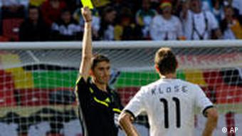 Alberto Undiano brandishes a yellow card