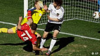 Serbia's Milan Jovanovic, center, scores the opening goal against Germany goalkeeper Manuel Neuer