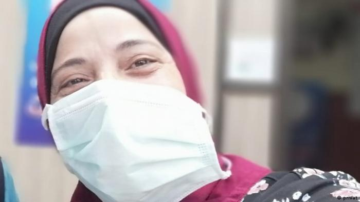 Kholoud Hussein with a face mask