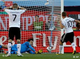 Lukas Podolski of Germany misses a penalty