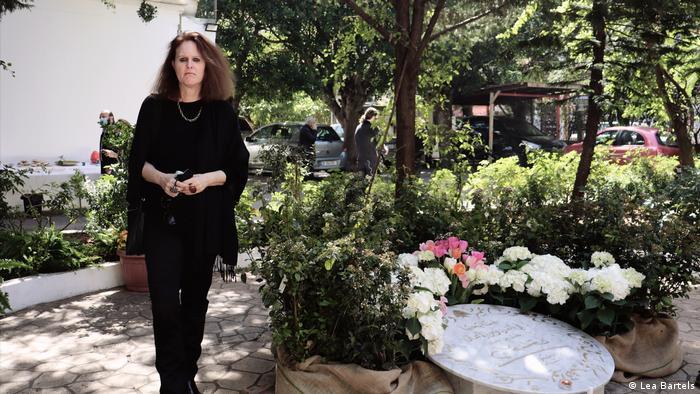 Monika Borgmann stands next to a memorial to her husband Lokman Slim