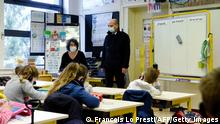 22.03.21 *** French Education Minister Jean-Michel Blanquer visits a classroom in a primary school in La Ferte-Milon, northern France, as part of the deployment of a nationwide Covid-19 saliva test campaign in schools, on March 22, 2021. (Photo by FRANCOIS LO PRESTI / AFP) (Photo by FRANCOIS LO PRESTI/AFP via Getty Images)