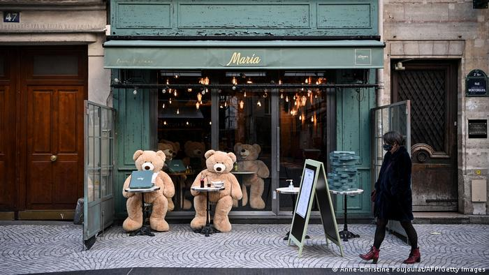 Teddy bears at tables in front of bistrot in France