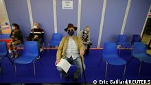 29.03.21 *** A man waits to receive the Comirnaty Pfizer-BioNTech COVID-19 vaccine in a vaccination center in Antibes as part of the coronavirus disease vaccination campaign in France, March 29, 2021. REUTERS/Eric Gaillard