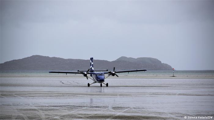 A Twin Otter DHC-6-400 at Barra Island Airport in Scotland