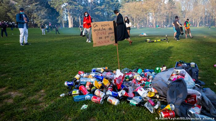 A pile of trash with a sign that reads 'On nous empeche de vivre pour ne pas mourir' (we are prevented from living so as not to die) at the Bois de La Cambre in Brussels, Thursday 01 April 2021.