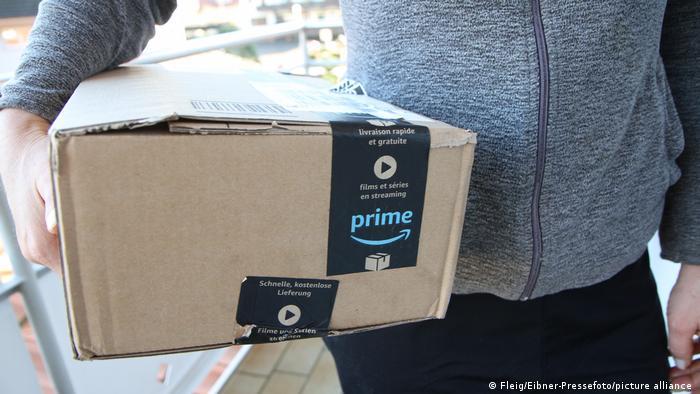 Worker delivering an Amazon Prime parcel