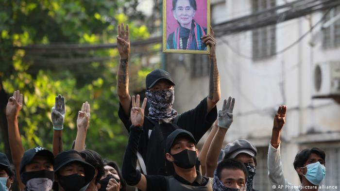 File photo: Anti-coup protesters raise the three finger of resistance and a portrait of ousted leader Aung San Suu Kyi.