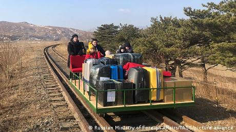 Russian embassy members using a hand-pushed rail trolley to get from North Korea to the Russian border