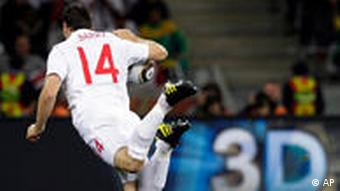 England's Gareth Barry is tackled by Algeria's Foued Kadir