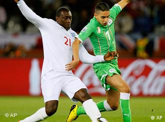 England's Emile Heskey, left, competes for the ball with Algeria's Riad Boudebouz