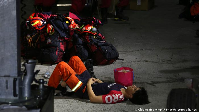 A rescue worker rests near the site of a derailed train near the Taroko Gorge area in Hualien, Taiwan