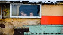 epa03603789 (04/20) Children look out of the window of a hut in a shantytown inhabited by Roma or Gypsy people in the Craica neighborhood of Baia Mare, northwestern Romania, 05 February 2013. Local authorities have been demolishing the shanties and rehousing Roma families in various types of accommodation, ranging from disused factories to old government offices, since 2011. Whilst they consider the group as illegal squatters, others argue that the forced evictions violate the rights of the Roma. The local government says that it is trying to lift the Roma out of poverty by giving them better housing and improving their access to education and employment. As of February 2013, plans to build modern social housing for the Roma consisting of 500 homes are in limbo, whilst funding is finalized and the search for a suitable site continues. EPA/ZSOLT CZEGLEDI PLEASE SEE ADVISORY NOTICE epa03603785 FOR FULL FEATURE TEXT - HUNGARY OUT ++ +++ dpa-Bildfunk +++