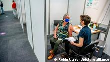 HOUTEN - Vulnerable elderly people are vaccinated with the astraZenica vaccine and the BioNTech / Pfizer vaccine against the corona virus at the Expo in Houten. It is very quiet at the location because the astraZenica vaccine was temporarily stopped. Robin Utrecht netherlands