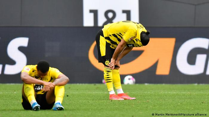 Borussia Dortmund players react to a defeat